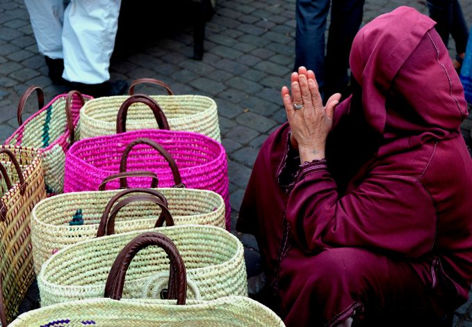 5 ways to explore Marrakech, Take time to immerse yourself in Jamaa el Fna square, Women in pink, Medina, Marrakech, Morocco,
